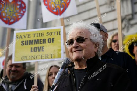 David Freiberg, who played with the Quicksilver Messenger Service and Jefferson Airplane bands, speaks in support of a Summer of Love anniversary concert during a rally outside City Hall, in San Francisco. The show might still go on but a concert planned to mark the 50th anniversary of the Summer of Love has hit another major bureaucratic hurdle. San Francisco's Recreation and Park Commission on Thursday upheld its decision earlier this month to deny a permit for the concert