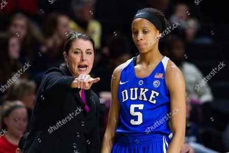 Blue Devils head coach Joanne McCallie directs Blue Devils forward Leaonna Odom (5) as she comes to the bench in the NCAA Womens Basketball matchup at LJVM Coliseum in Winston-Salem, NC