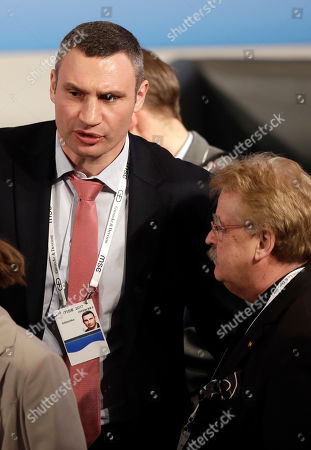 Kiev Mayor Vitali Klitschko talks to Elmar Brok, right, during the Munich Security Conference in Munich, southern Germany, . The annual weekend gathering is known for providing an open and informal platform to meet in close quarters