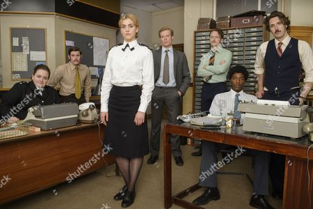 'Prime Suspect 1973' (Episode 2) - L-R : Jessica Gunning as Kath Morgan, Tommy McDonnell as DC Hudson, Stefanie Martini as Jane Tennison, Sam Reid as DCI Len Bradfield, Joshua Hill as DC Edwards, Daniel Ezra as DC Ashton and Blake Harrison as DS Spencer Gibbs.