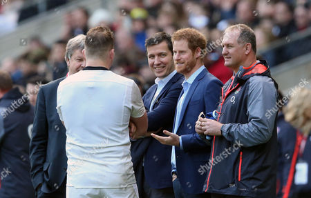 Dylan Hartley (Captain) of England chats with Prince Harry (Centre) with Richard Hill (R)