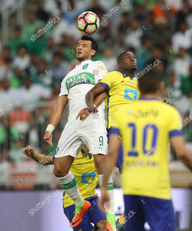 Al-Ahli player Omar Al-Somah (L) in action for the ball with Al-Nassr player Omar Hawsawi (R) during the Saudi Professional League soccer match between Al-Ahli and Al-Nassr at King Abdullah Al Jawhara International Stadium in Jeddah, Saudi Arabia, 17 February 2017.