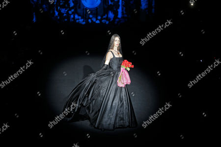 Stock Picture of Lucia, younger sister of Spanish model Bimba Bose who died recently of cancer, displays a 2017-18 Fall/Winter long dress by Spanish designer Francis Montesinos during the Madrid's Fashion Week in Madrid