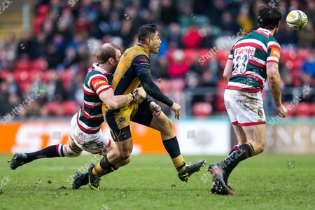 Tusi Pisi of Bristol Rugby is tackled by Tom Croft of Leicester Tigers