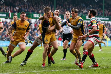 Jason Woodward of Bristol Rugby is tackled by JP Pietersen of Leicester Tigers