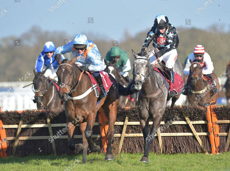 Stock Image of (R-stars) Air Horse One (Noel Fehily) takes the last before going on to win The Les Ambassadeurs Casino Handicap Hurdle Race from (L) Divine Spear (Ned Curtis) at Ascot Racecourse on Saturday 18th February 2017.