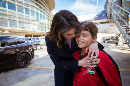 Her Majesty Queen Rania picks up HRH Prince Hashem from the airport as he arrives from Dubai where his team won 1st place in the Middle Eastern Unity Cup Football Championship