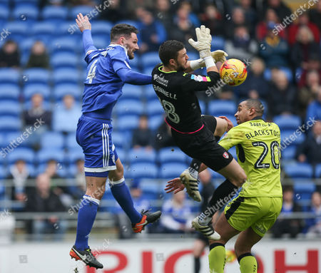 Sean Morrison of Cardiff City puts Rotherham United goalkeeper Richard O?Donnell under pressure