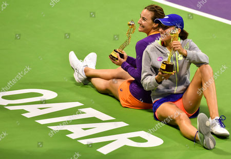 Abigail Spears (L) of United States And Katarina Srebotnik (R) of Slovakia celebrate winning against Olga Savchuk of Ukraine and Yaroslava Shvedova of Kazahkstan during their doubles final match of the WTA Qatar Ladies Open at the International Khalifa Tennis Complex in Doha, Qatar, 18 February 2017.