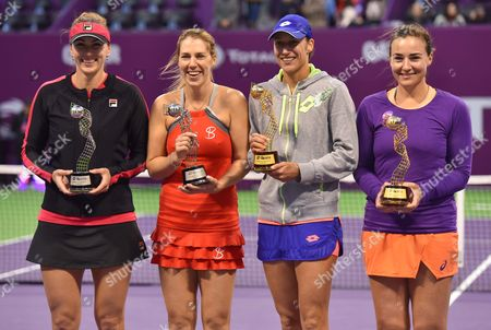 Abigail Spears (R) of United States and Katarina Srebotnik (2nd R)of Slovakia  pose with their trophies after beating Olga Savchuk of Ukraine and Yaroslava Shvedova of Kazahkstanin during their doubles final match of the WTA Qatar Ladies Open at the International Khalifa Tennis Complex in Doha, Qatar, 18 February 2017.