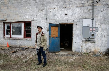 """Stock Picture of Author Ed Maliskas stands outside a dilapidated dance hall in Dargan, Md., that hosted dozens of black performers including James Brown, Ray Charles, Etta James and Otis Redding during the racially segregated 1950s and early '60s. The structure stands on the same property as the house where abolitionist John Brown launched his 1859 seizure of a federal armory in nearby Harpers Ferry, W.Va. """"I think it should be considered the No. 1 black history site in the United States,"""" said Maliskas. author of a self-published volume about the property"""