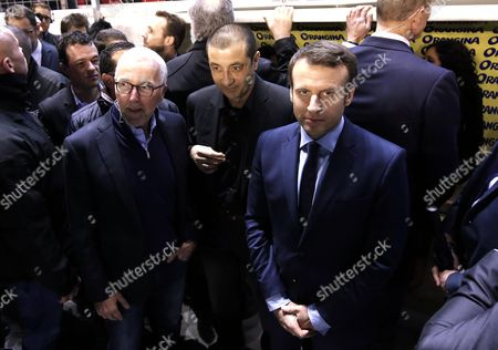 Independent candidate for the 2017 French Presidential Elections Emmanuel Macron (R) attends the rugby match between RC Toulon and Lyon with RC Toulon's owner Mourad Boudjellal (C) and Olympique Marseille's owner, US businessman Frank McCourt (L)  at the Stade Mayol in Toulon, France, 18 February 2017. The first round of the 2017 French presidential election will be held on 23 April 2017.