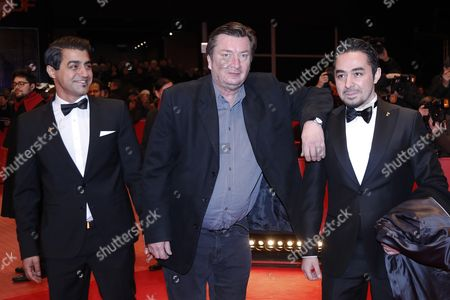 Actor Simon Hussein Al-Bazoon (L), Finnish director Aki Kaurismaki  and actor Sherwan Haji arrive for the Closing and Awards Ceremony of the 67th annual Berlin Film Festival, in Berlin, Germany, 18 February 2017. The Berlinale runs from 09 to 19 February.