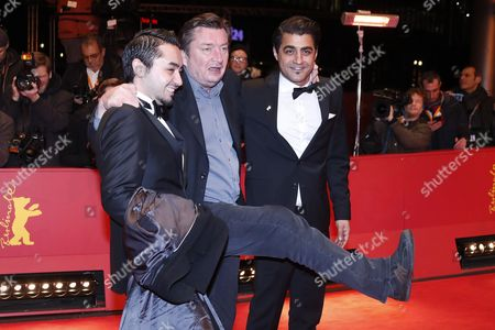 Actor Simon Hussein Al-Bazoon (R), Finnish director Aki Kaurismaki  and actor Sherwan Haji (L) arrive for the Closing and Awards Ceremony of the 67th annual Berlin Film Festival, in Berlin, Germany, 18 February 2017. The Berlinale runs from 09 to 19 February.