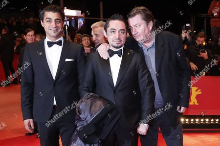 Actor Simon Hussein Al-Bazoon (L), Finnish director Aki Kaurismaki (R)  and actor Sherwan Haji (C) arrive for the Closing and Awards Ceremony of the 67th annual Berlin Film Festival, in Berlin, Germany, 18 February 2017. The Berlinale runs from 09 to 19 February.