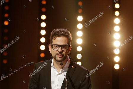 Stock Photo of Director Diogo Costa Amarante speaks to the audience after winning the Golden Bear for Best Short Film for 'Cidade Pequena' during the award ceremony at the 2017 Berlinale Film Festival in Berlin, Germany