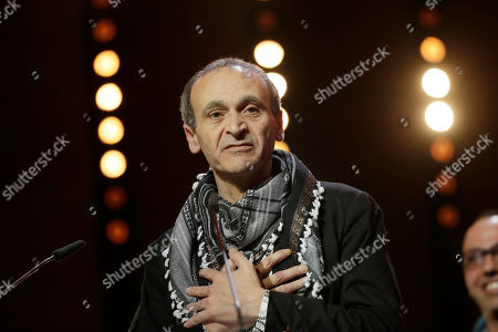 Director Raed Andoni speaks to the audience after winning the Original Documentary Award for 'Istiyad Ashbah (Ghost Hunting)' during the award ceremony at the 2017 Berlinale Film Festival in Berlin, Germany