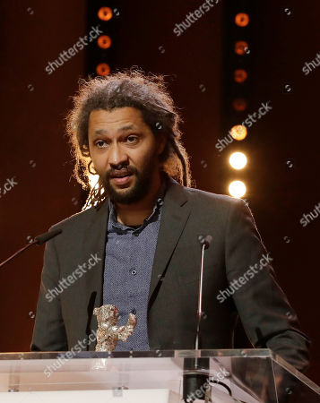 Alain Gomis speaks to the audience after winning the Silver Bear Grand Jury Prize for 'Felicite' during the award ceremony at the 2017 Berlinale Film Festival in Berlin, Germany