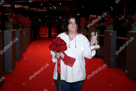 Stock Image of Editor Dana Bunescu poses for photographers after winning the Silver Bear Outstanding Artistic Contribution award for 'Ana, Mon Amour!' during the award ceremony at the 2017 Berlinale Film Festival in Berlin, Germany