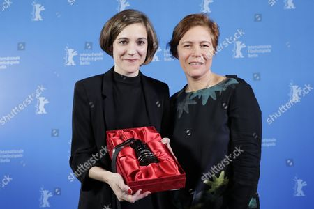 Stock Image of Spanish director Carla Simon (L) poses with producer Valerie Delpierre (R) and the GWFF Best First Feature Award prize during the closing ceremony of the 67th annual Berlin International Film Festival, in Berlin, Germany, 18 February 2017.  The Berlinale runs from 09 to 19 February