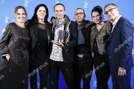 Stock Image of Winner for the Glashuette Original Documentary Award Raed Andoni (C) poses during the closing and award ceremony of the 67th annual Berlin International Film Festival, in Berlin, Germany, 18 February 2017. The Berlinale runs from 09 to 19 February.