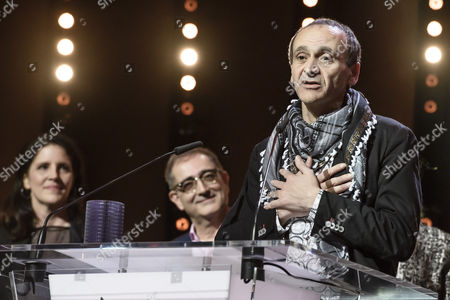 Stock Photo of Winner for the Glashuette Original Documentary Award Raed Andoni (C) receives his award during the closing and award ceremony of the 67th annual Berlin International Film Festival, in Berlin, Germany, 18 February 2017. The Berlinale runs from 09 to 19 February.