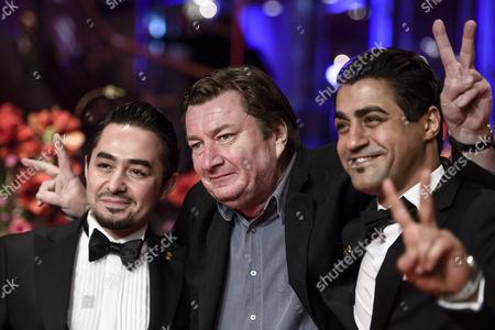 Stock Picture of Simon Hussein Al-Bazoon, Aki Kaurismaki and Sherwan Haji