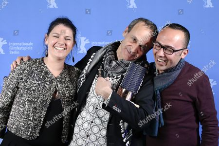 Stock Picture of Winner for the Glashuette Original Documentary Award Raed Andoni (C) poses during the closing and award ceremony of the 67th annual Berlin International Film Festival, in Berlin, Germany, 18 February 2017. The Berlinale runs from 09 to 19 February.