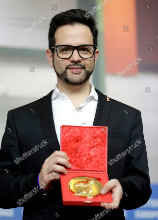 Stock Image of Director Diogo Costa Amarante poses for the photographers with his Best Short Film golden bear for the film 'Small Town' during the award winners press conference at the 2017 Berlinale Film Festival in Berlin, Germany
