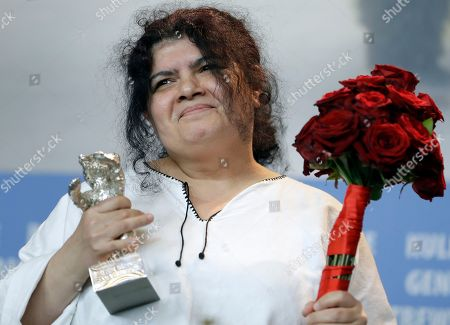 Stock Photo of Dana Bunescu poses for the photographers with her Outstanding Artistic Contribution Silver Bear for the Film 'Ana, mon amour' during the award winners press conference at the 2017 Berlinale Film Festival in Berlin, Germany