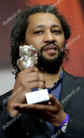 Director Alain Gomis poses for the photographers with his Grand Jury Prize silver bear for the film 'Felicite' during the award winners press conference at the 2017 Berlinale Film Festival in Berlin, Germany