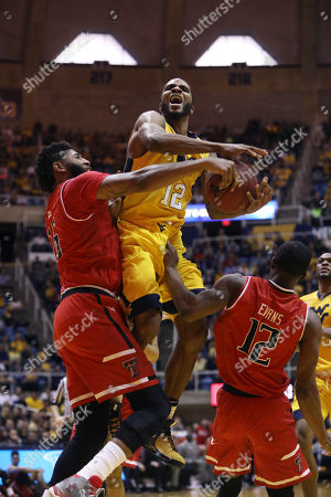 Tarik Phillip, Aaron Ross West Virginia guard Tarik Phillip (12) is fouled as he drives to the basket by Texas Tech forward Aaron Ross (15) during the second half of an NCAA college basketball game, in Morgantown, W.Va. West Virginia defeated Texas Tech 83-74 in overtime
