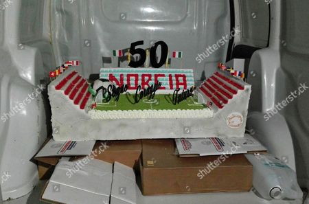Stock Photo of A cake is prepared for former Italian forward Roberto Baggio during his visit to one of the areas stricken by the earthquake on August 24 and October 26, in Norcia, Italy, 18 February 2017. Baggio celebrates his 50th birthday on 18 Februar 2017.