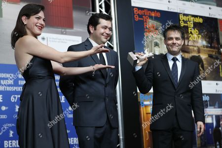 Stock Photo of Sebastian Lelio (R), Daniela Vega and Gonzalo Maza (C) pose with the Silver Bear for Best Script for the movie 'Una Mujer Fantastica' for the movie 'Una mujer Fantastica'  during the Award Winners press conference after the Closing and Awards Ceremony of the 67th annual Berlin Film Festival, in Berlin, Germany,  18 February 2017. The Berlinale runs from 09 to 19 February.