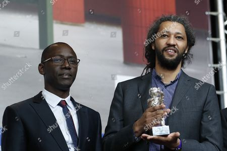 French director Alain Gomis (R) poses with the Silver Bear Jury Grand Prix for the movie 'Felicite' during the Award Winners press conference after the Closing and Awards Ceremony of the 67th annual Berlin Film Festival, in Berlin, Germany,  18 February 2017. The Berlinale runs from 09 to 19 February.