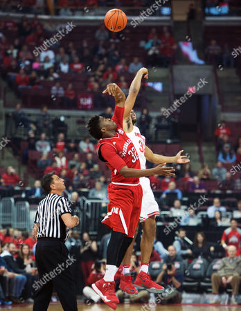 Nebraska Cornhuskers center Jordy Tshimanga (32) wins the tip off against Ohio State Buckeyes center Trevor Thompson (32) in their game at Value City Arena in Columbus, Ohio