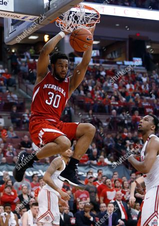 Ed Morrow, Trevor Thompson Nebraska forward Ed Morrow dunks in front of Ohio State center Trevor Thompson during the first half of an NCAA college basketball game in Columbus, Ohio