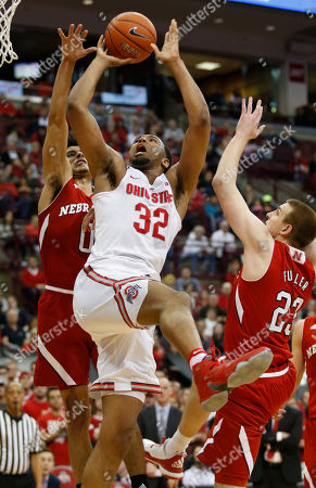 Trevor Thompson, Tai Webster, Nick Fuller Ohio State center Trevor Thompson, center, goes up to shoot between Nebraska guard Tai Webster, left, and forward Nick Fuller during the second half of an NCAA college basketball game in Columbus, Ohio
