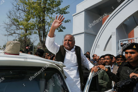 Samajwadi Party leader Mulayam Singh Yadav waves to supporters after casting his vote at a polling station in Saifai, in Etawah, Uttar Pradesh, India, . Uttar Pradesh and four other Indian states are having state legislature elections in February-March, a key mid-term test for Prime Minister Narendra Modi's Hindu nationalist government which has been ruling India since 2014