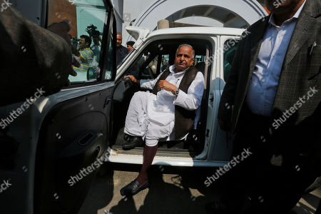 Samajwadi Party leader Mulayam Singh Yadav arrives to cast his vote at a polling station in Saifai, in Etawah, Uttar Pradesh, India, . Uttar Pradesh and four other Indian states are having state legislature elections in February-March, a key mid-term test for Prime Minister Narendra Modi's Hindu nationalist government which has been ruling India since 2014