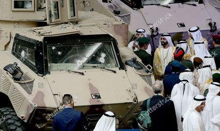 H.H. Sheikh Mohammad Bin Rashid Al Maktoum Ruler of Dubai (C-R) views armored vehicles on the first day of the International Defence Exhibition and Conference IDEX in Abu Dhabi, United Arab Emirates, 19 February 2017. The exhibition also includes NAVDEX, the naval and maritime security section of the fair.