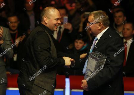 Stuart Bingham is presented the trophy by Ray Reardon.