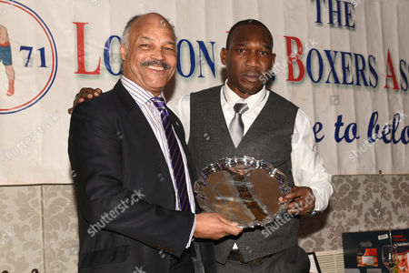 Stock Image of Ovill McKenzie (R) receives the Special Award for Services To Boxing from John Conteh during the London Ex-Boxers Awards at the Grand Connaught Rooms on 19th February 2017