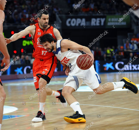 Real Madrid´s base Sergio Llull (R) and Valencia´s guard Rafa Martinez (L) during the King's Cup final match played at Fernando Buesa Arena, Vitoria, Spain, 19 February.