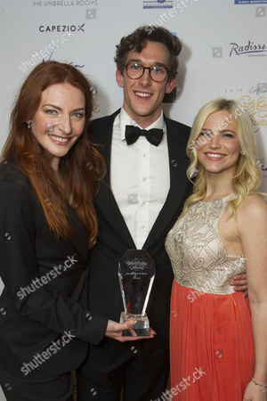 Willemijn Verkaik, Oliver Savile and Suzie Mathers accept the award for Best West End Show for Wicked