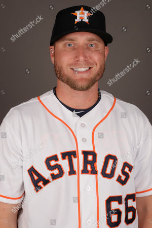 Houston Astros' Kevin Chapman poses for a photograph before a spring training baseball workout, in West Palm Beach, Fla