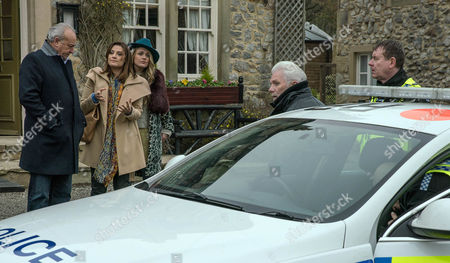 Stock Image of Ronnie, as played by John McArdle, is guided to the police car by the police but the truth is soon revealed. (Ep 7763 - Thur 2 Mar 2017)
