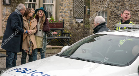 Ronnie, as played by John McArdle, is guided to the police car by the police but the truth is soon revealed. (Ep 7763 - Thur 2 Mar 2017)