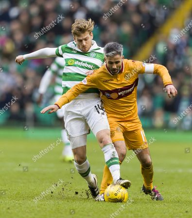Stuart Armstrong of Celtic tackles Keith Lasley of Motherwell during the SPFL Ladbrokes Premiership match between Celtic & Motherwell at Celtic Park, Glasgow on 18th Febuary