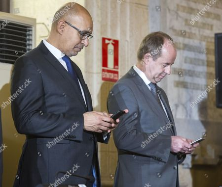 French Justice minister Jean-Jacques Urvoas (R) and State for European Affairs' secretary Harlem Desir (L) look at their mobile phones during the signing of agreements between Spanish Prime Minister, Mariano Rajoy and French President, Francois Hollande (both not pictured) on the ocassion of the 25th Spain-France bilateral Summit in Malaga, southeastern Spain, 20 February 2017. Rajoy and Hollande head delegations taking part in the one-day long summit, that will focus on Britain's 'Brexit', the rapid rise of populism and uncertainty over the future relationship between the European Union and US President Donald Trump's Government.